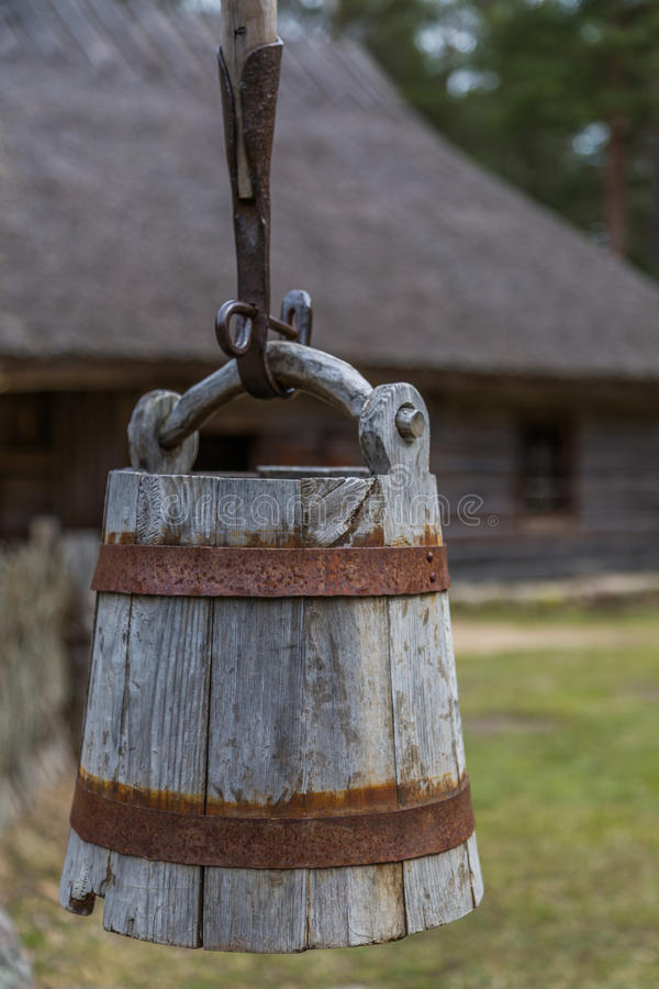 Traditional wooden country hut and well stock photography