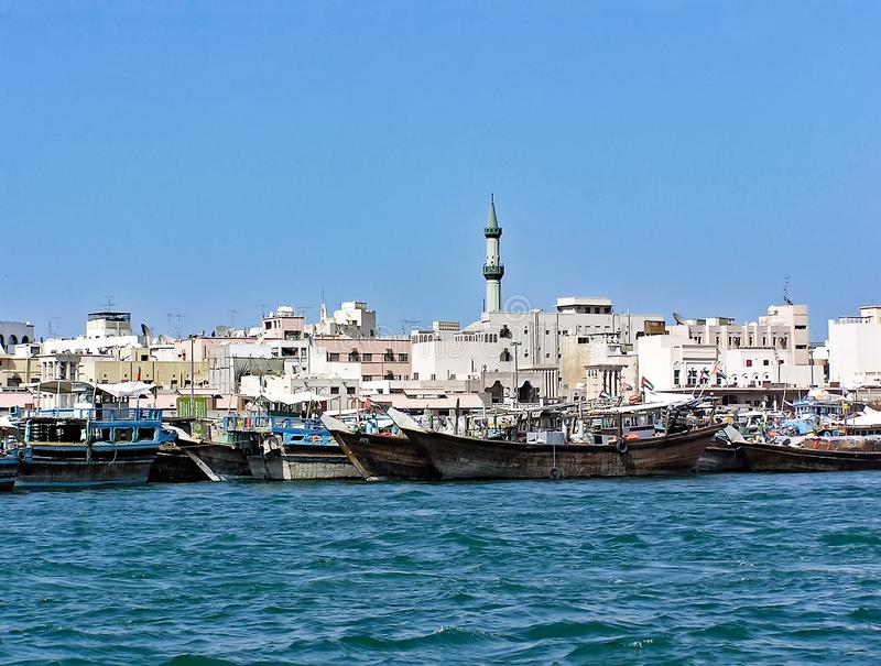 Traditional wooden Dhows moored on the creek in Dubai in the district Deira stock photos