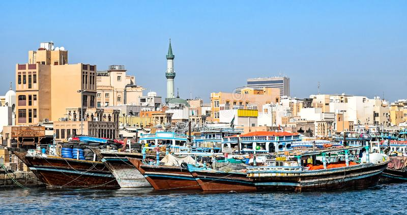 Traditional wooden Dhows moored on the creek in Dubai in the district Deira. United Arab Emirates stock photos