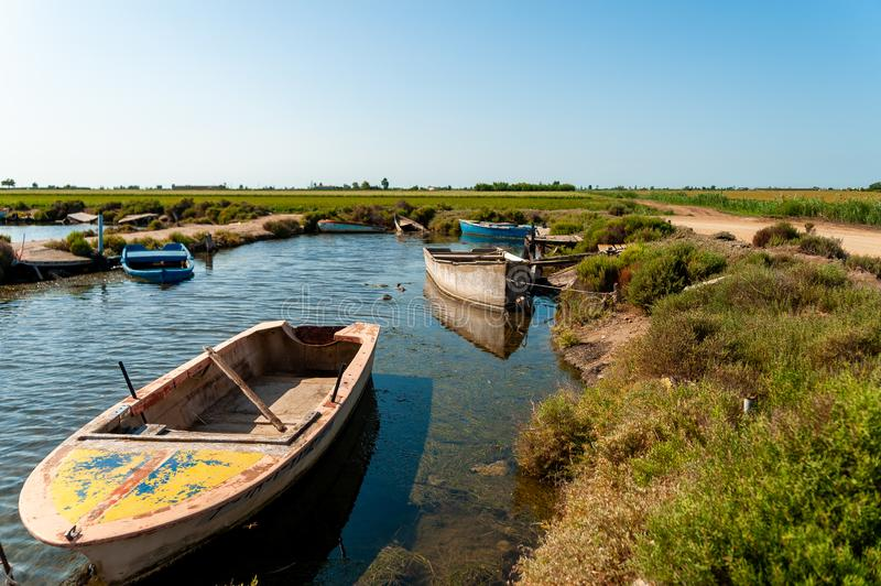 Traditional wooden fishing boats abandoned in ebro delta national park in catalonia, symbol of fishing problems and economic. Crisis royalty free stock photo