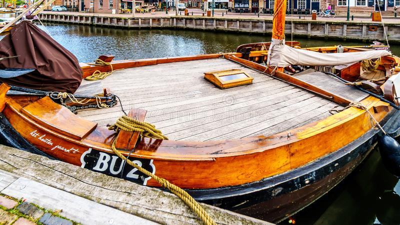 Fishing Boats moored in the harbor of Bunschoten-Spakenburg in. Traditional Wooden Fishing Boats, called Botters, moored in the harbor of the historic fishing royalty free stock photos