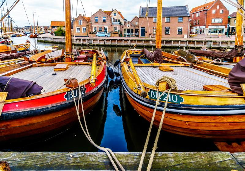 Fishing Boats moored in the harbor of Bunschoten-Spakenburg in. Traditional Wooden Fishing Boats, called Botters, moored in the harbor of the historic fishing royalty free stock photo