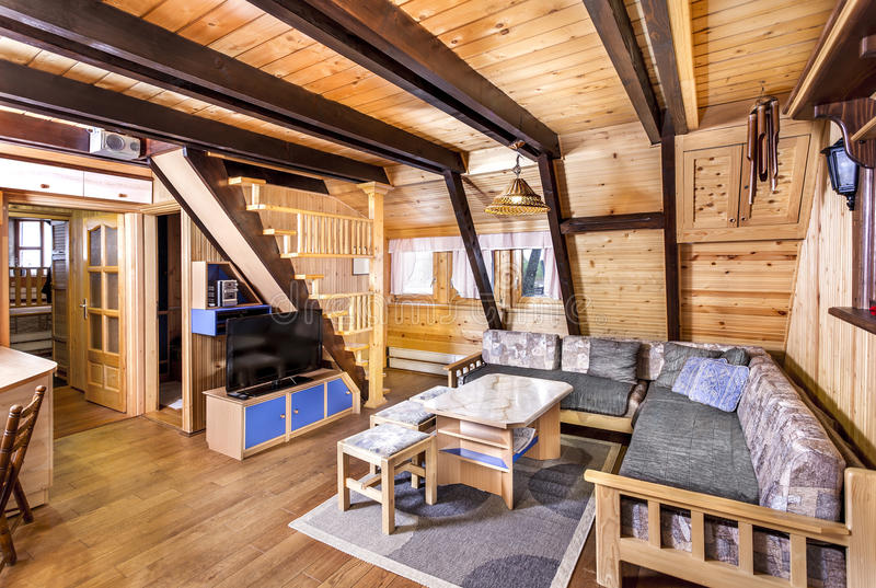Traditional wooden interior with table and fixtures - mountain resort.  royalty free stock images
