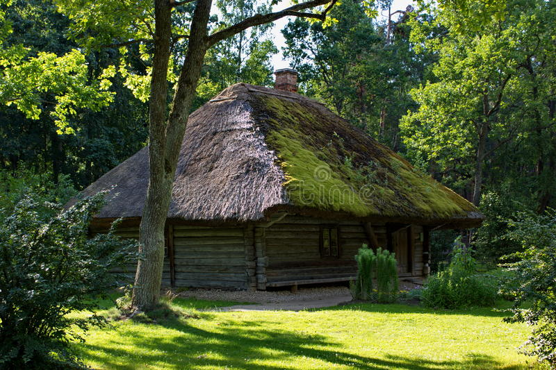 Traditional wooden latvian house, open air museum in Riga stock images