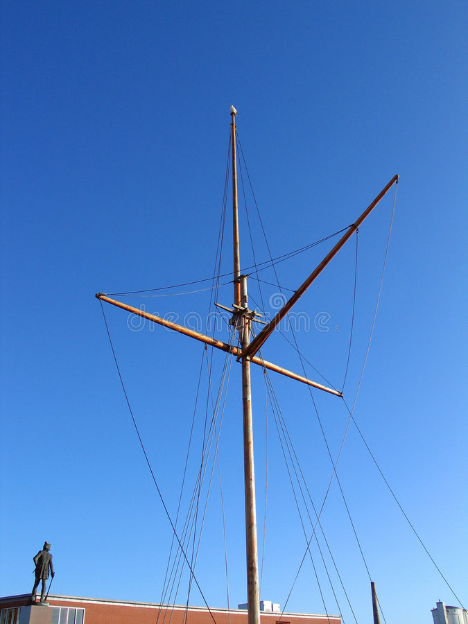 Traditional Wooden mast. Of an old sail boat with clear sky background royalty free stock photography