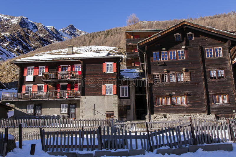 Traditional wooden old houses on a background mountains in Swiss resort of Saas-Fee stock images
