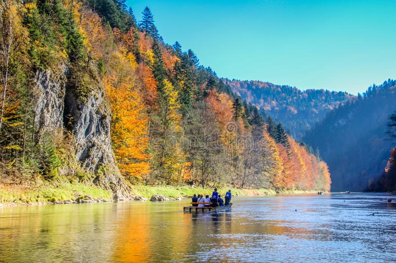 Traditional wooden Raft boat with tourists floating along Dunajec river gorge stock photography