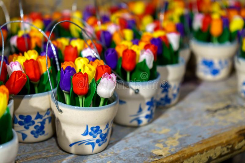 Traditional Wooden tulips in little buckets in souvenir shop stock photos