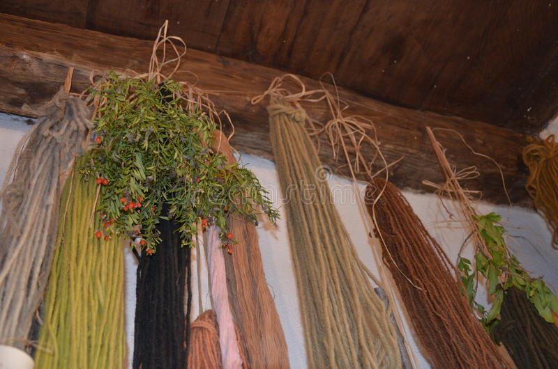 Traditional wool dyeing. A Traditional wool dyeing in the house stock photography