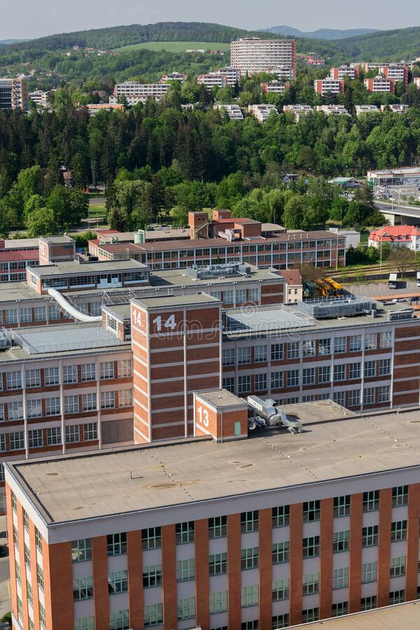 Traditional Zlin red brick buildings exterior, former shoe factory, Moravia, Czech Republic, sunny summer day. Aerial view stock images