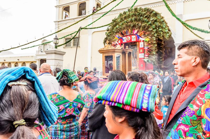 Traditionallly dressed locals participate in religious procession, Guatemala. Parramos, Guatemala - December 28, 2016: Traditionallly dressed locals participate royalty free stock photography