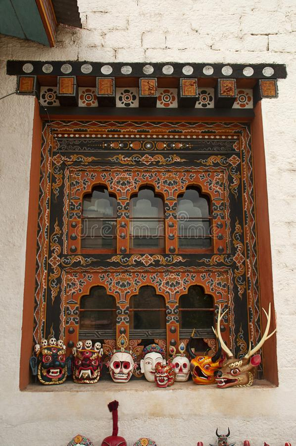 Traditionally decorated window and wooden masks, Thimpu, Bhutan stock photos