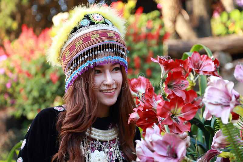 Traditionally dressed Mhong hill tribe woman in the garden stock image