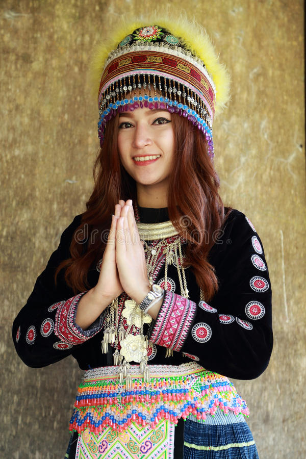 Traditionally dressed Mhong hill tribe woman pay respect stock image