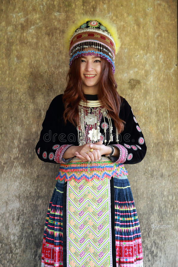 Traditionally dressed Mhong hill tribe woman. In the wooden cottage royalty free stock photos