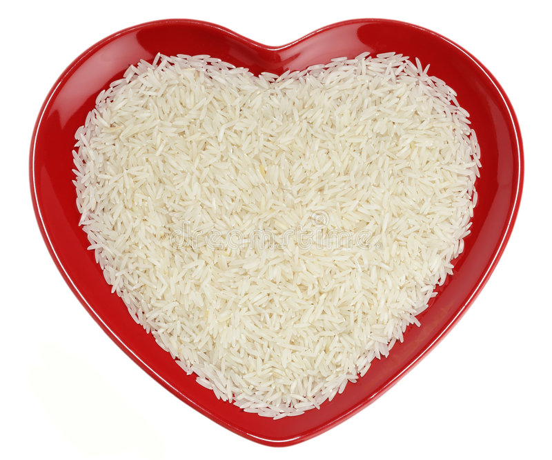 Traditionally Indian basmati Rice in red heart stock photos