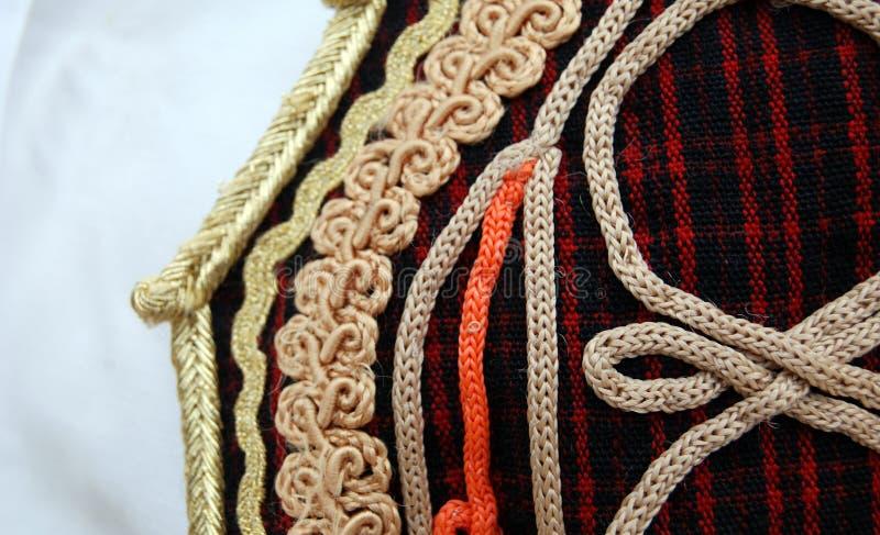 Traditioneel Macedonisch kostuum, details stock fotografie