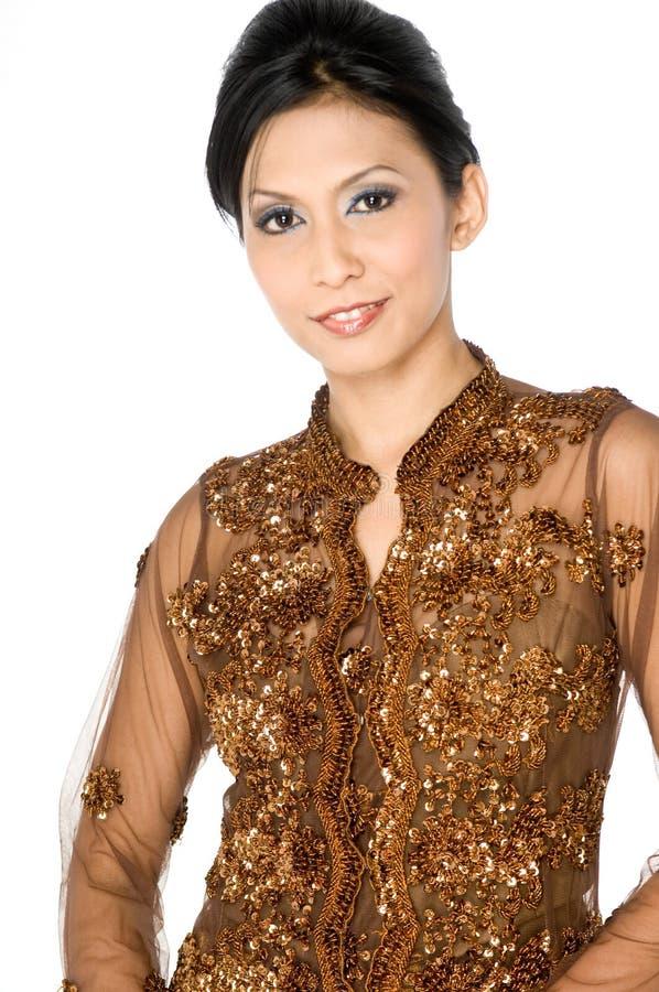 Traditionell asiatisk klänning arkivbilder