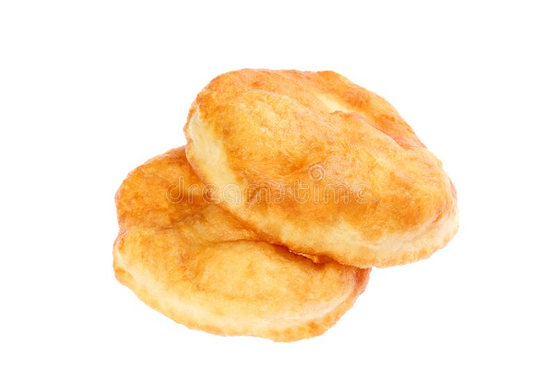 Traditionell bulgarisk hemlagad munk som frukosten som namnges Mekitsa eller Mekica som isoleras p? vit bakgrund Mekitsa g?ras av royaltyfria bilder