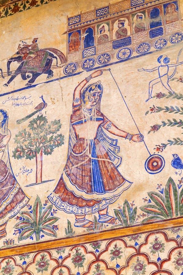 Traditionell freskomålning på väggen av ett Haveli hus i Bikaner, Indien arkivbild