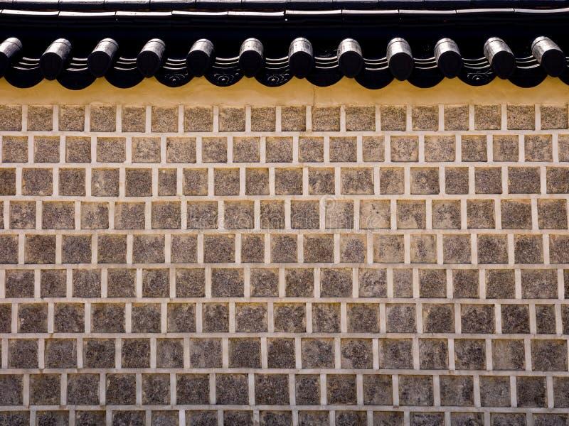 Traditionell koreansk arkitektur, stenar väggen i den Gyeongbokgung slotten, Seoul, Sydkorea arkivfoto