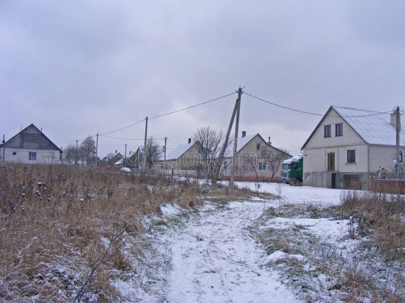 Traditionell ryss eller belarussian by, vinter i Slonim, Vitryssland royaltyfri fotografi