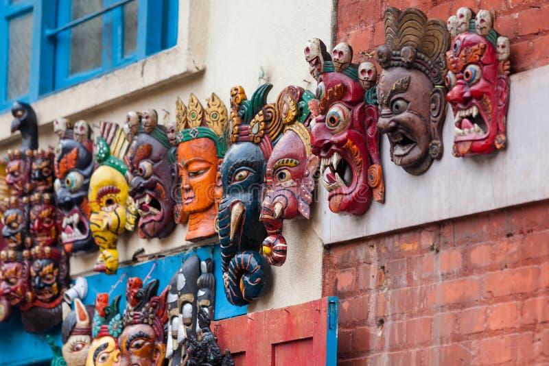Traditionella nepalese trämaskeringar royaltyfri foto