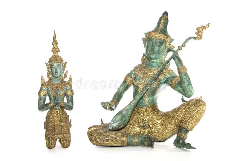 Traditionelle thailändische Bronzestatuen lokalisiert gegen ein weißes backgro stockfoto