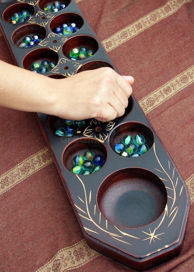 Traditionelles Spiel Congkak stockbild