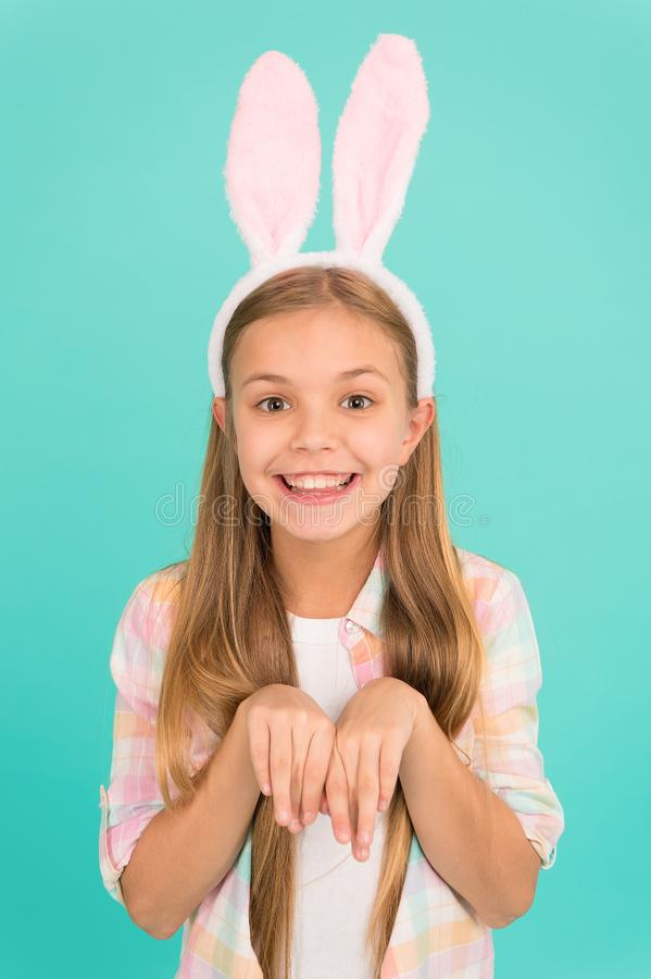 Traditions for kids to help get in easter spirit. Bunny ears accessory. Easter activities. Cute bunny. Holiday bunny. Girl posing with cute long ears. Child royalty free stock photos