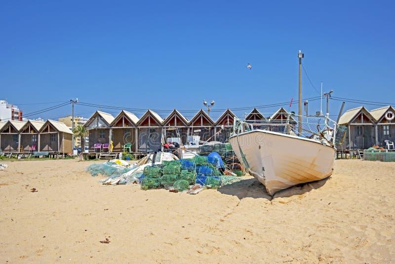 Traditonal fisherman huts on the beach in Armacao de Pera in the Algarve Portugal. Europe stock image