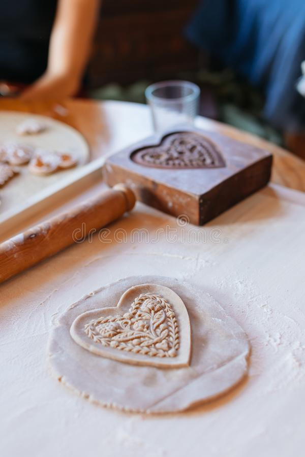 Traditional home-made gingerbread baking. Wooden pressed gingerbread heart. Budapest, Hungary royalty free stock photo