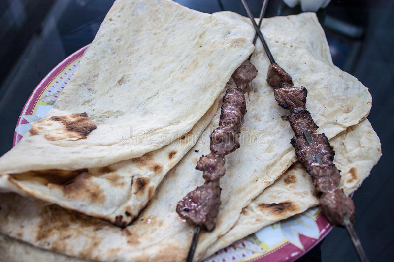 Tradtional food in Iran. Kabab with flat bread royalty free stock images