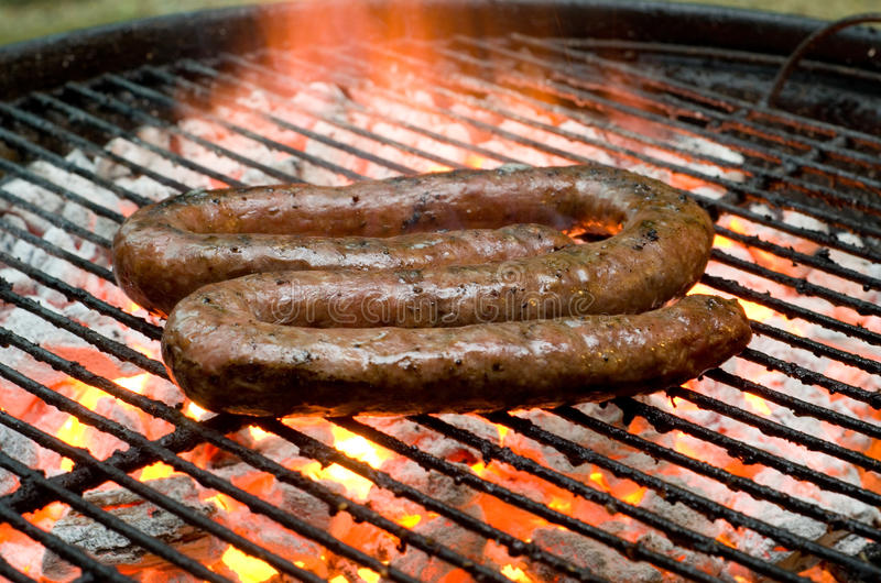 Tradtional South African braai barbecue borewors sausage on fire. Tradtional South African braai barbecue borewors sausage royalty free stock photo