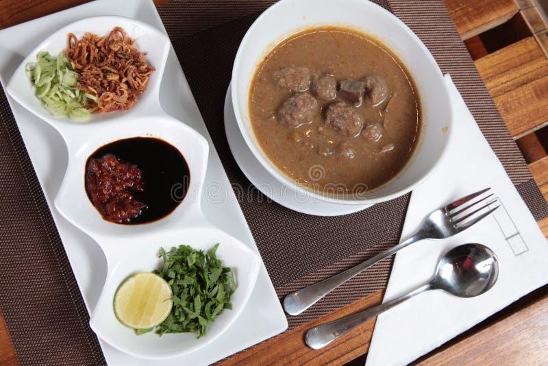 Tradtionalvoedsel van Makassar genoemde coto stock fotografie