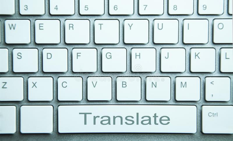 Traduisez le bouton sur le clavier d'ordinateur Traduction en ligne servic image libre de droits