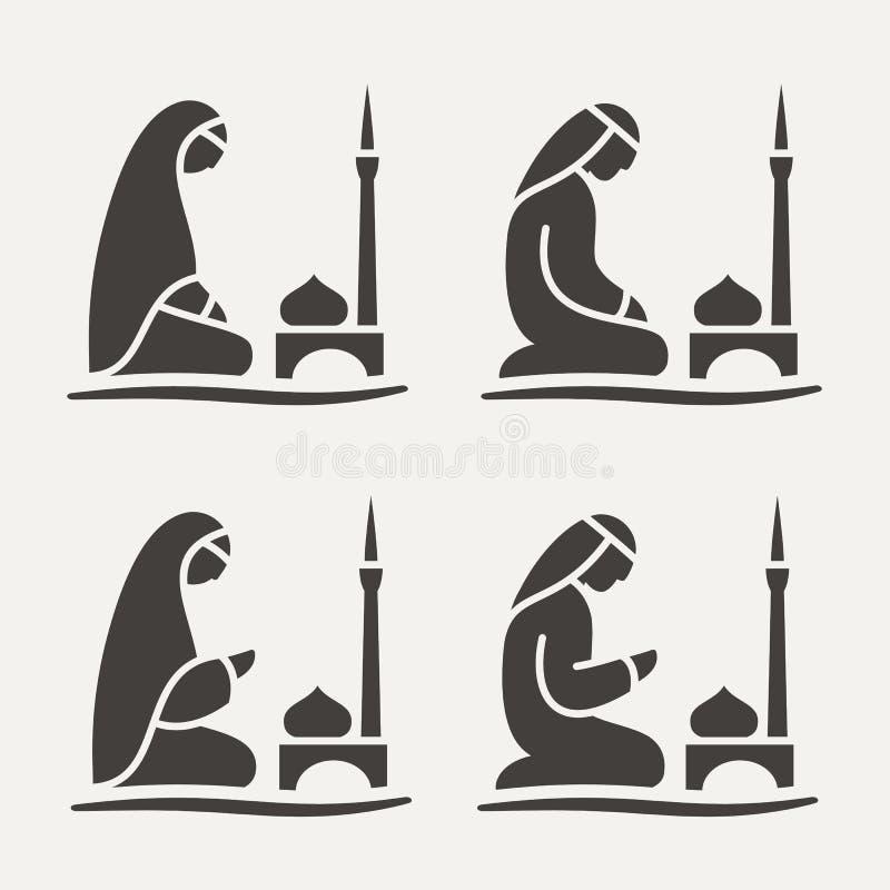 Tradycjonalnie okryty Muzułmański Arabski mężczyzna i kobieta robi suplice Salah na ono modli się dywaniku podczas gdy siedzący obraz stock