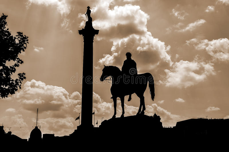 Trafalgar Square at dusk. A beautiful photograph of Trafalgar Square at dusk using a sepia lens. The silhouette clearly outlines Nelsons column & King Charles 1 stock image
