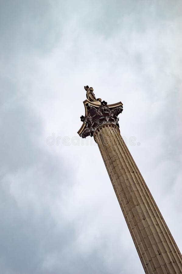 Trafalgar square london and plinth of nelson column in the sky. With clouds filled in stock photography