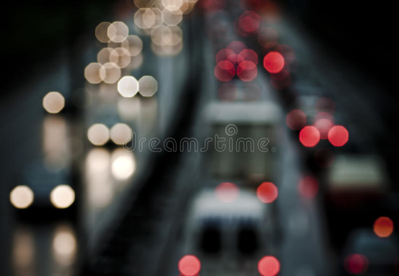 Traffic. Extremely soft focus picture of wet street and cars with lights. Grunge style with some dirty noise royalty free stock photos