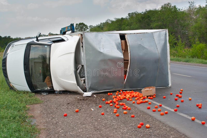 Traffic accidents. Road traffic accidents with an overloaded truck tomatoes stock photography