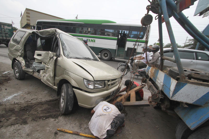 Traffic accidents due to driver negligence. A heavily damaged car after involved in a traffic accident in Solo, Java, Indonesia. Frequent accidents caused by the stock images