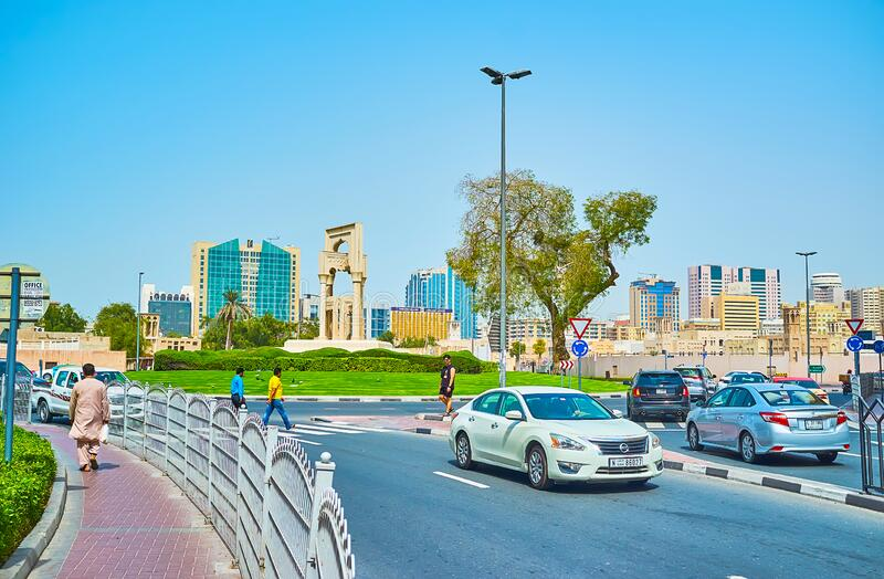 The traffic in Al Fahidi roundabout, Dubai, UAE. DUBAI, UAE - MARCH 2, 2020: The fast traffic in Al Fahidi roundabout, decorated with sculptural composition and royalty free stock photography