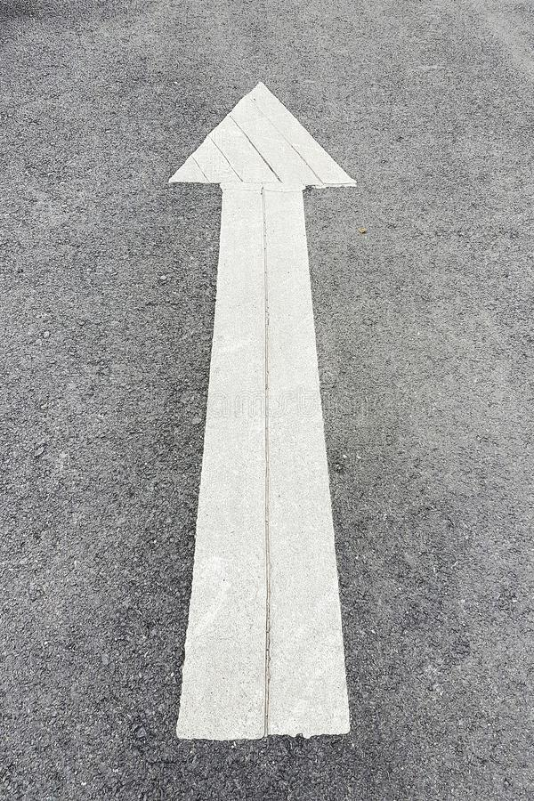 Traffic arrow sign on street. Rule, road, transportation, one-way, exit-sign, asphalt, guidance, tarmac, driving, direction, information, road-sign, traffic royalty free stock photos