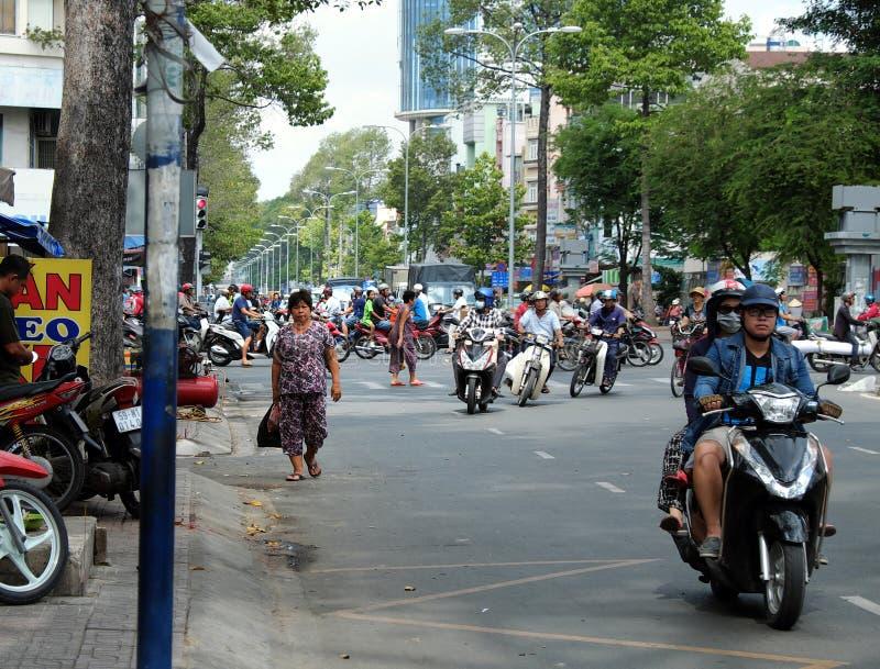 Traffic at Asia city, walker walk on roadway stock image