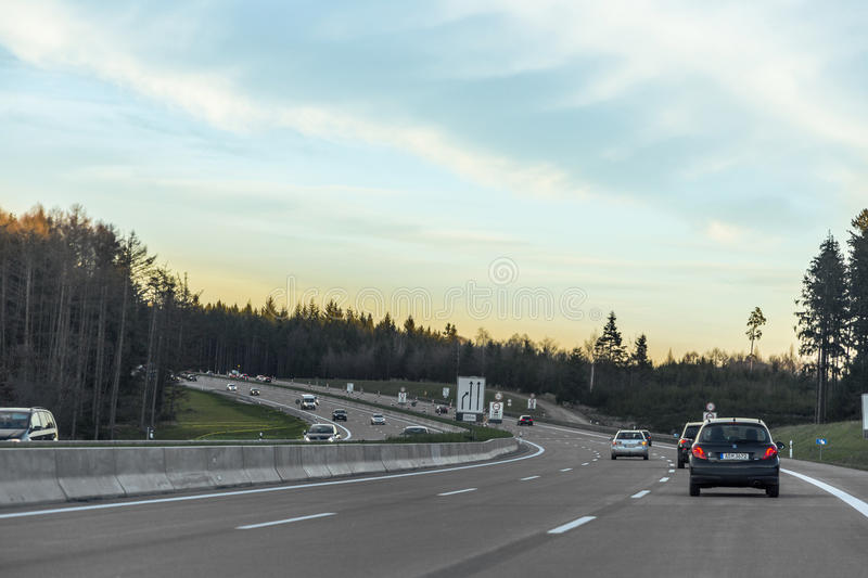 Traffic on the autobahn during sunset. Cars on the autobahn (Federal Motorway 8) near Burgau on December 23, 2014 during sunset stock photos