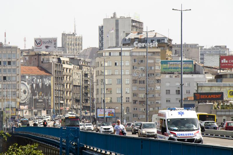 Traffic at Branko bridge with driving vehicles and pedestrians walking,with the view on the city royalty free stock photos