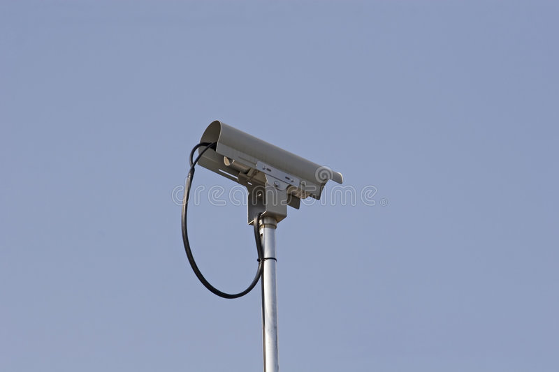 Traffic Cam. A traffic camera against a blue sky royalty free stock images