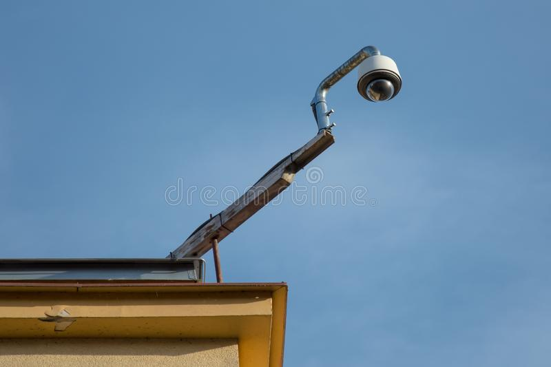 Traffic cam on the roof. Traffic cam mounted on the roof of the building overseeing busy street with intersection royalty free stock images