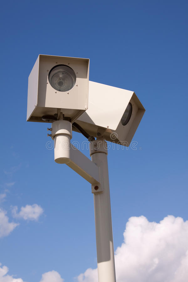 Traffic camera. Photo radar traffic camera over blue sky stock images